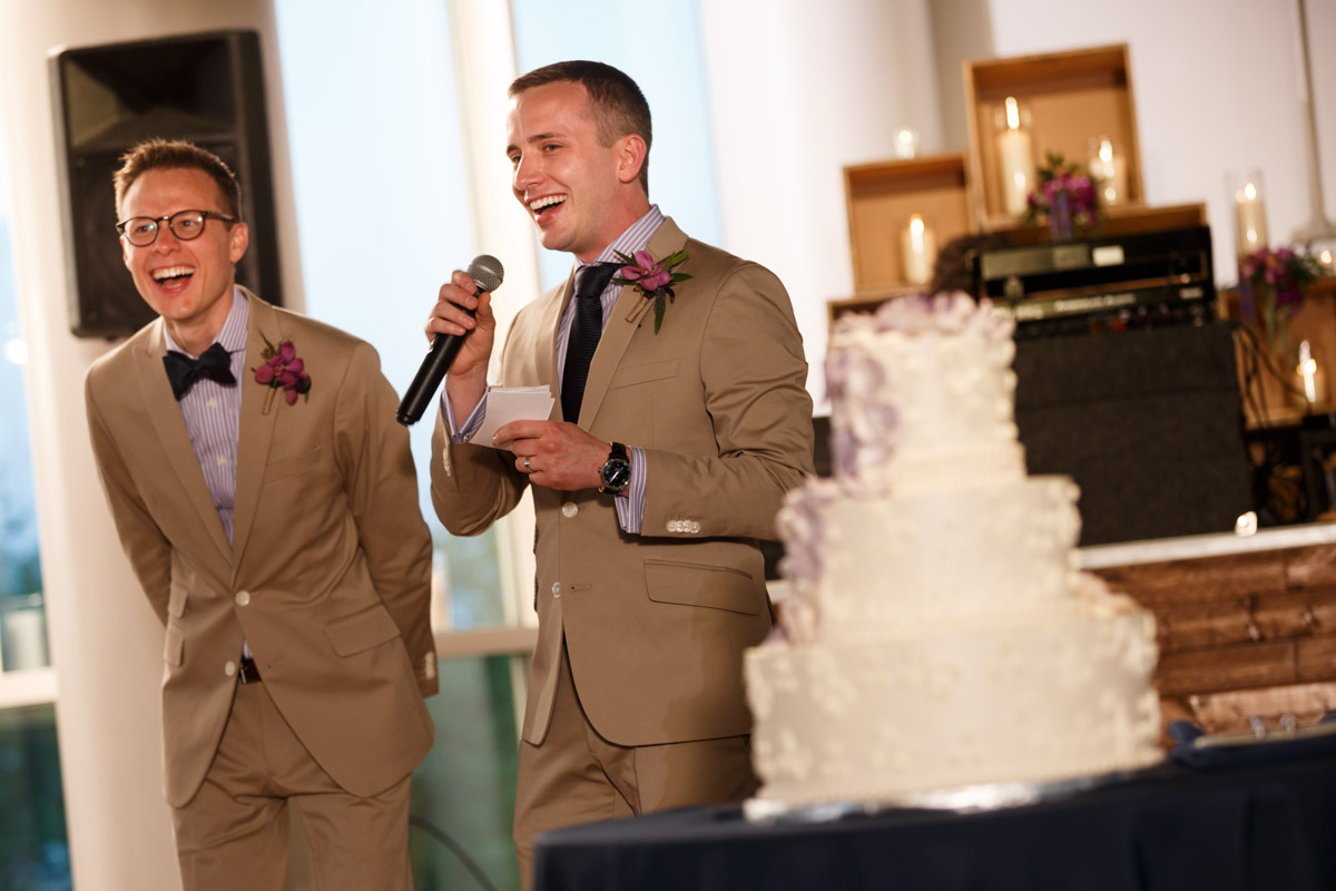 Gay couple welcomes guest to their wedding reception at the Peggy Notebaert Nature Museum in Chicago