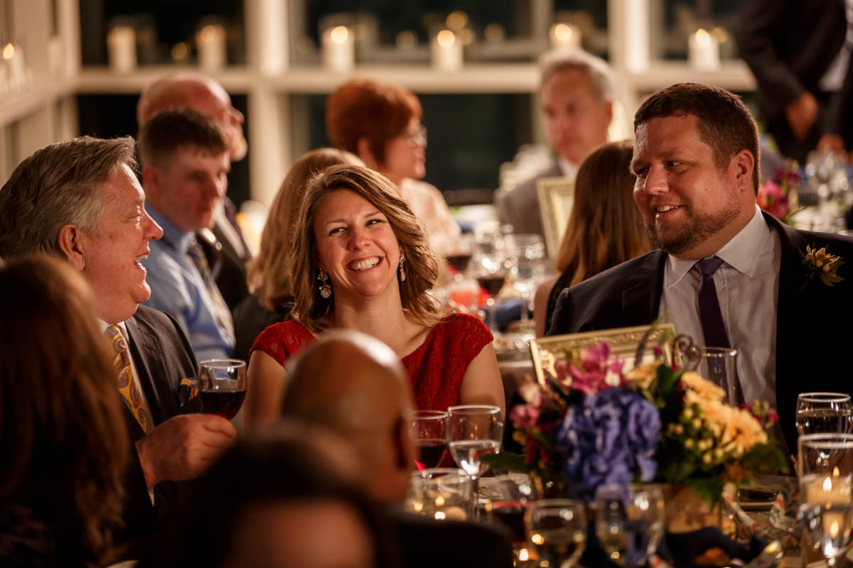 Guests laugh during a wedding at the Peggy Notebaert Nature Museum in Chicago