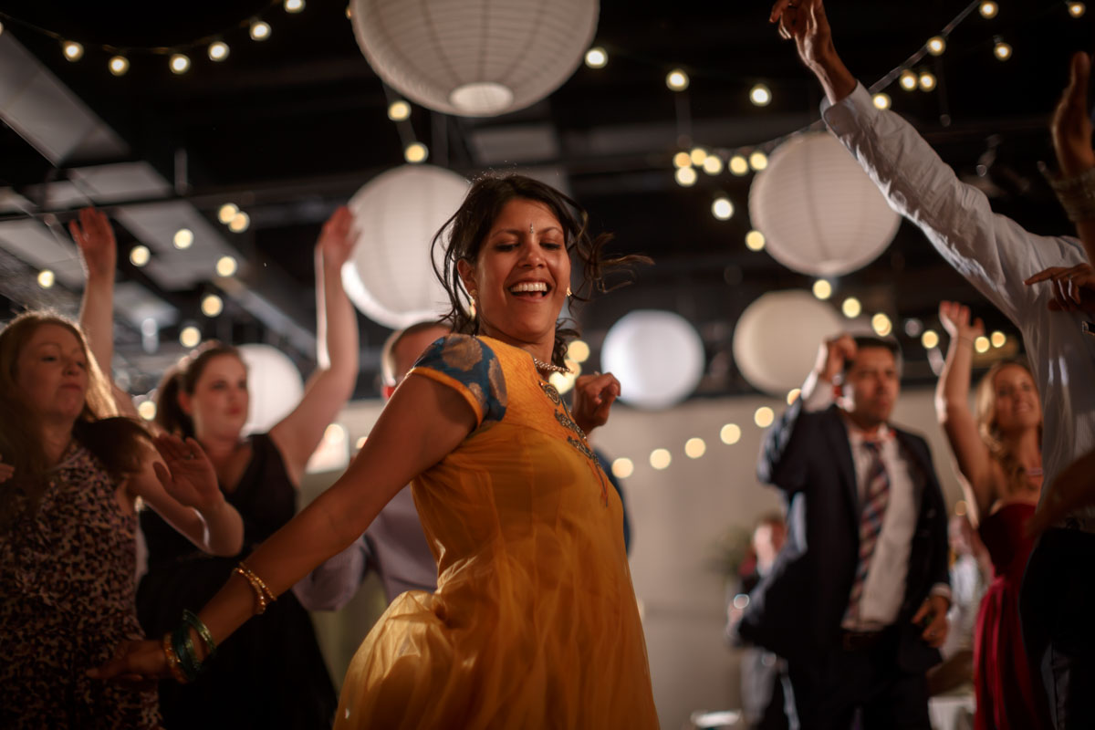 Indian woman dances at CHicago gay wedding