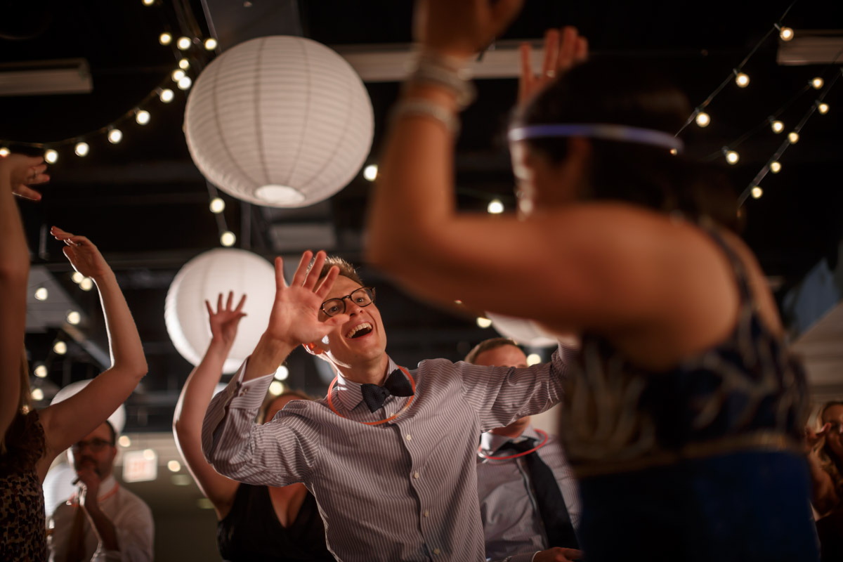 Groom dances during a gay wedding at the Peggy Notebaert Nature Museum in Chicago