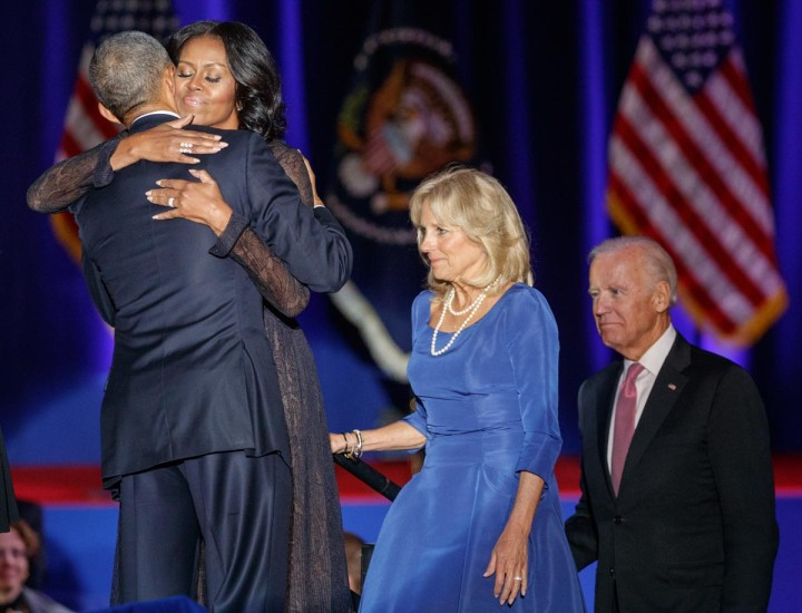 U.S. President Barack Obama hugs his wife Michelle as Vice-President Joe Biden and his wife Jill look on after the President delivered a farewell address at McCormick Place in Chicago, Illinois