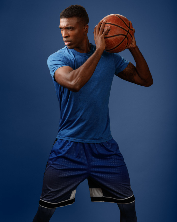Chicago mens fashion model photoshoot with male model kenneth hill basketball colorful backdrop
