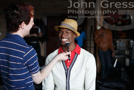 MUA Brandon Phillips and Sean Crack a smile while prepping for the second look.